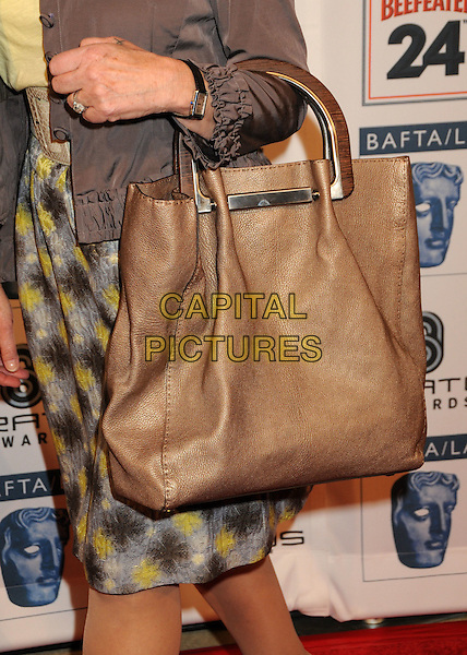DAME HELEN MIRREN's bag .Attending the 16th Annual BAFTA LA Awards Season Tea Party held at the Beverly Hills Hotel, Beverly Hills, California, USA, 16th January 2010..arrivals detail tote wooden handles  brown .CAP/ADM/BP.©Byron Purvis/Admedia/Capital Pictures