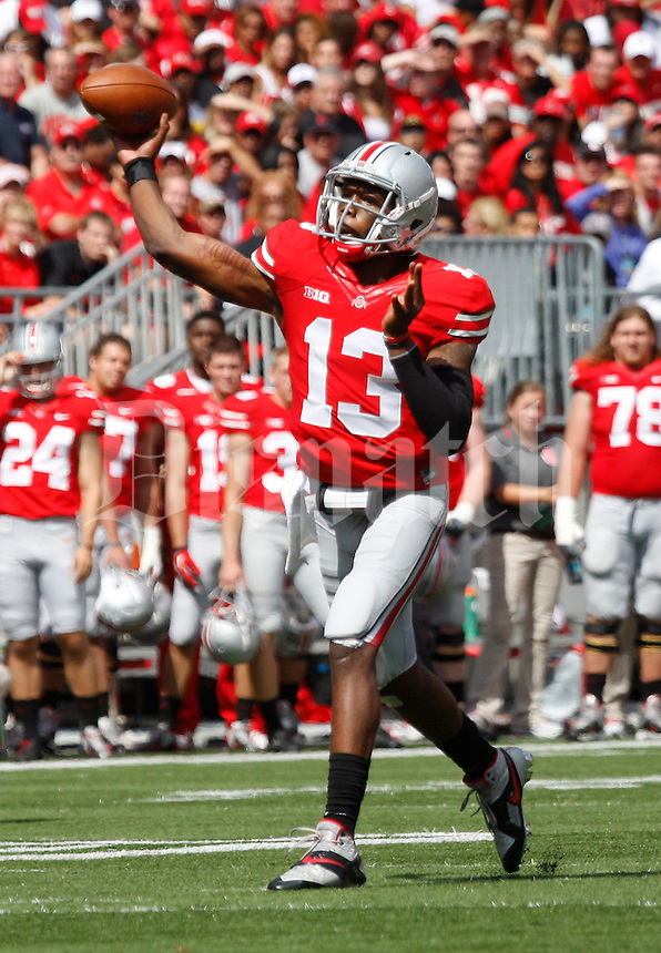 Ohio State Buckeyes quarterback Kenny Guiton (13) throws a touchdown pass to wide receiver Chris Fields (80) during the second quarter of the NCAA football game at Ohio Stadium in Columbus on Sept. 21, 2013. (Adam Cairns / The Columbus Dispatch)