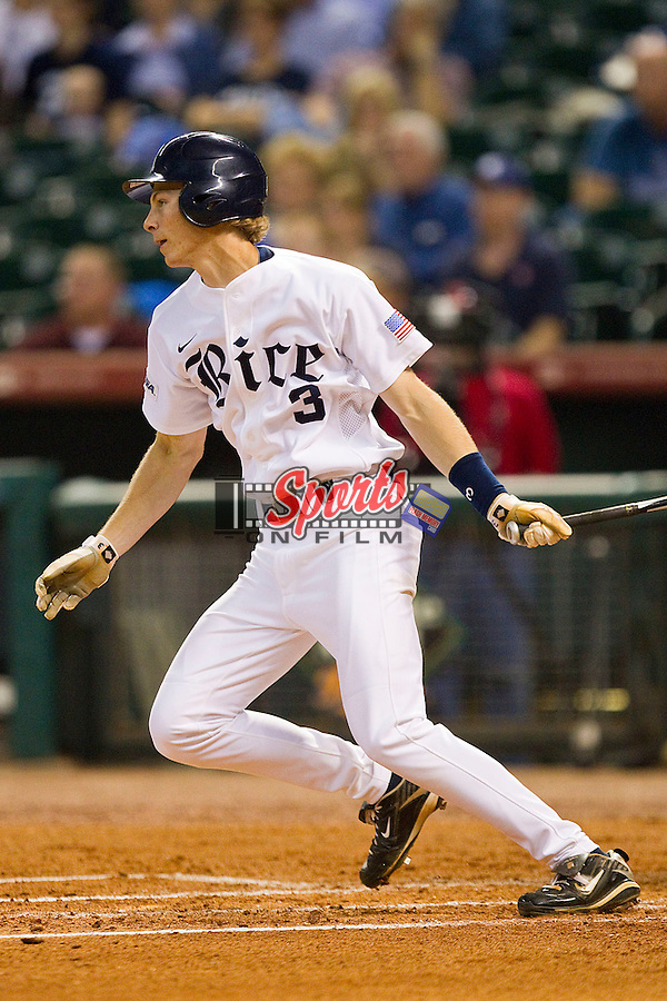 Jeremy Rathjen #3 of the Rice Owls follows through on his swing against the Kentucky Wildcats at Minute Maid Park on March 4, 2011 in Houston, Texas.  Photo by Brian Westerholt / Four Seam Images