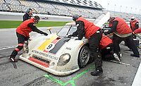 The #9 Porsche Riley of Joao Barbosa, Terry Borcheller, Ryan Dalziel and Mike Rockenfeller makes a pit stop en route to victory in the Rolex 24 at Daytona, Daytona International Speedwway, January 31, 2010.  (Photo by Brian Cleary/www.bcpix.com)