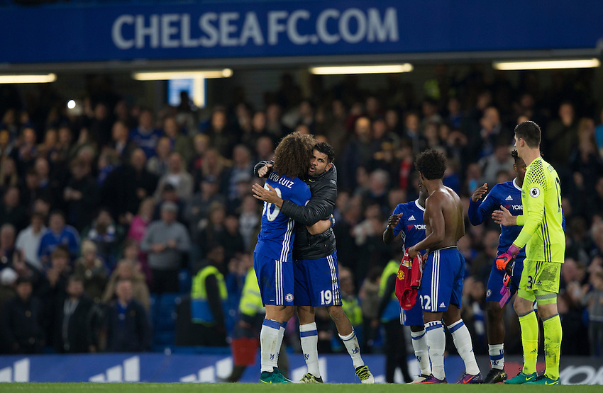 Chelsea's Diego Costa celebrates with team mate David Luiz at full time<br /> <br /> Photographer Craig Mercer/CameraSport<br /> <br /> The Premier League - Chelsea v Manchester United - Sunday 23rd October 2016 - Stamford Bridge - London<br /> <br /> World Copyright &copy; 2016 CameraSport. All rights reserved. 43 Linden Ave. Countesthorpe. Leicester. England. LE8 5PG - Tel: +44 (0) 116 277 4147 - admin@camerasport.com - www.camerasport.com