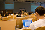 A Conference of youth Delegate takes notes during a presentation at the 4th Annual Conference of Youth. UNFCCC COP 14 (©Robert vanWaarden ALL RIGHTS RESERVED)