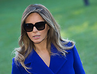 First lady Melania Trump listens as United States President Donald J. Trump speaks to the media before departing the White House in Washington, DC, November 3, 2017 for a multi-day trip to Hawaii and then on to Asia.<br /> Credit: Chris Kleponis / CNP /MediaPunch