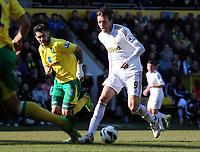 Pictured: Michu of Swansea (R) against Bradley Johnson (L) of Norwich.  Saturday 06 April 2013<br />