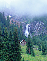 Cabin and waterfall near Silverton, Colorado.