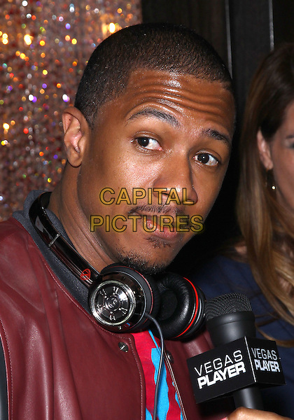 Nick Cannon.Carmen Electra performs live at Grand Opening of Pussycat Dolls Burlesque Saloon at Planet Hollywood Casino Resort, Las Vegas, Nevada, USA..June 4th, 2011.headshot portrait burgundy maroon leather moustache mustache facial hair headphones .CAP/ADM/MJT.© MJT/AdMedia/Capital Pictures.