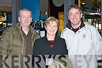CHEERING: Crokes supporters Peter OGrady, Helen Howard and Michael Howard prepare to board their flight to London last Friday to cheer on their team in the All Ireland quarter final in Ruislip..