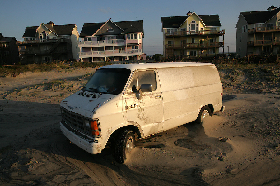 A van is stuck in the sand behind the Frisco Pier in Frisco, NC, along the Outer Banks after Hurricane Irene on Sunday, Aug. 28, 2011. Photo by Ted Richardson