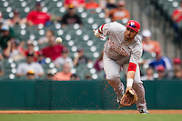 Houston Cougars third baseman Justin Montemayor #20 fields a ground ball during the NCAA baseball game against the Texas Longhorns on March 1, 2014 during the Houston College Classic at Minute Maid Park in Houston, Texas. The Longhorns defeated the Cougars 3-2. (Andrew Woolley/Four Seam Images)