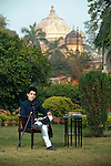 Amir Khan of Mehmudabad, shot in Lucknow, with Sadaat Ali Khan's Tomb in the background.