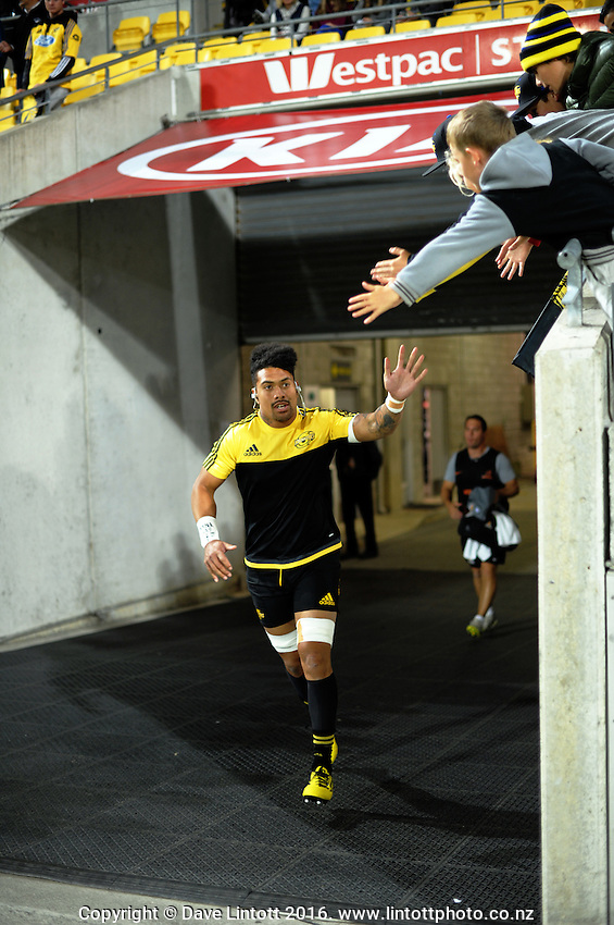 Ardie Savea runs out for the Super Rugby match between the Hurricanes and Jaguares at Westpac Stadium, Wellington, New Zealand on Saturday, 9 April 2016. Photo: Dave Lintott / lintottphoto.co.nz