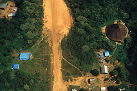 Gold mining illegal landing-strip at Yanomami indigenous people territory in Paapiu  ( or Papiu ) area, Roraima State, Amazon rain forest, Brazil -  Gold miners invasion of native land, indigenous house surrounded by gold mining tents.