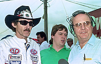 NASCAR legends Richard Petty, left, and Benny Parsons, right, before the Daytona 500, Daytona International Speedway, Daytona Beach, FL, February 1990.  (Photo by Brian Cleary/www.bcpix.com)