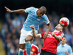 Fernandinho of Manchester City challenges Morgan Schneiderlin of Manchester United during the Barclays Premier League match at The Etihad Stadium. Photo credit should read: Simon Bellis/Sportimage