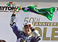 Owasldo Negri Jr. celebrates in victory lane after winning the Rolex 24 at Daytona, Daytona International Speedway, Daytona Beach, FL, January 2011.  (Photo by Brian Cleary/www.bcpix.com)
