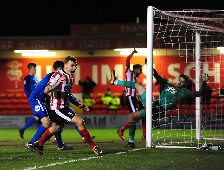 Lincoln City's Harry Anderson celebrates scoring his sides third goal<br /> <br /> Photographer Chris Vaughan/CameraSport<br /> <br /> The EFL Checkatrade Trophy Fourth Round - Lincoln City v Peterborough United - Tuesday 23rd January 2018 - Sincil Bank - Lincoln<br />  <br /> World Copyright © 2018 CameraSport. All rights reserved. 43 Linden Ave. Countesthorpe. Leicester. England. LE8 5PG - Tel: +44 (0) 116 277 4147 - admin@camerasport.com - www.camerasport.com