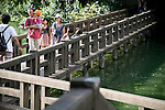 Visitors walk across a bridge in  Inokashira Park in  the trendy neighborhood of Kichijoji in Musashino City,  Tokyo, Japan on 16 Sept. 2012.  Photographer: Robert Gilhooly