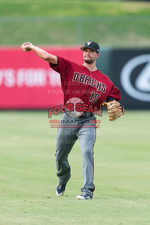AZL Diamondbacks shortstop Jack Reinheimer (15) warms up before making a rehab appearance in an Arizona League game against the AZL Angels at Tempe Diablo Stadium on July 16, 2018 in Tempe, Arizona. The AZL Diamondbacks defeated the AZL Angels by a score of 4-3. (Zachary Lucy/Four Seam Images)