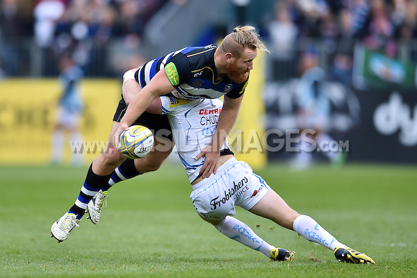 Ross Batty of Bath Rugby looks to offload the ball after being tackled. Aviva Premiership match, between Bath Rugby and Exeter Chiefs on October 17, 2015 at the Recreation Ground in Bath, England. Photo by: Patrick Khachfe / Onside Images