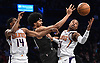 Jarrett Allen #31 of the Brooklyn Nets, center, draws a foul on Richaun Holmes #21 of the Phoenix Suns, right, as they and De'Anthony Melton #14 of the Suns battle for control of a rebound during the second quarter of an NBA game at the Barclays Center in Brooklyn, NY on Sunday, Dec. 23, 2018.