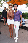 "Fashion designer Edwing D'Angelo posing with guest at his Edwing D'Angelo Spring Summer 2019 ""Pristine"" collection fashion show at Sofrito in New York City on July 11, 2018; during New York Fashion Week: Men's Spring Summer 2019."