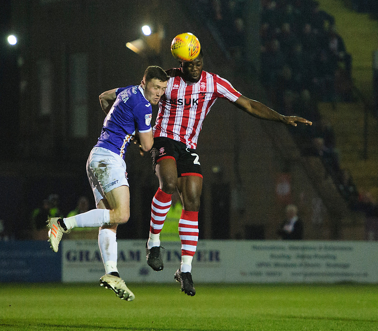 Lincoln City's John Akinde vies for possession with Exeter City's Dara O'Shea<br /> <br /> Photographer Chris Vaughan/CameraSport<br /> <br /> The EFL Sky Bet League Two - Lincoln City v Exeter City - Tuesday 26th February 2019 - Sincil Bank - Lincoln<br /> <br /> World Copyright © 2019 CameraSport. All rights reserved. 43 Linden Ave. Countesthorpe. Leicester. England. LE8 5PG - Tel: +44 (0) 116 277 4147 - admin@camerasport.com - www.camerasport.com