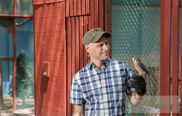 Chris Soucy, holding a Amercian Kestrel, The Raptor Trust, New Jersey