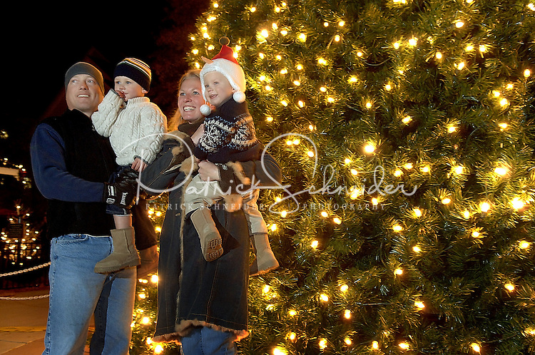 A family has its photo taken by the lighted tree during the annual Christmas tree lighting event at Birkdale Village in Huntersville, NC. Birkdale Village combines the best of shopping, dining, apartments and entertainment venues within a 52-acre mixed-use development.