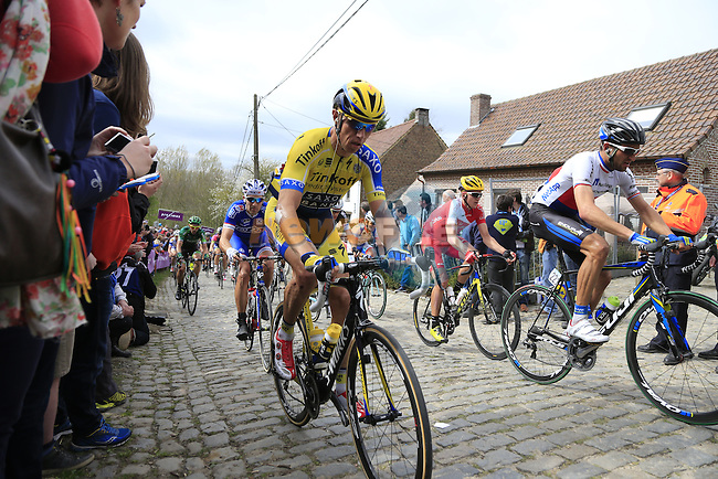 The peleton, including Nicki Sorensen (DEN) Tinkoff-Saxo, climb the Molenberg during the 2014 Tour of Flanders, Belgium.<br /> Picture: Eoin Clarke www.newsfile.ie
