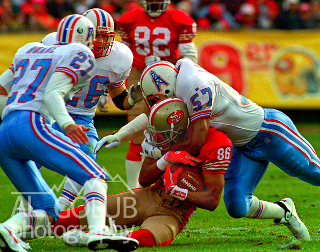 San Francisco 49ers vs. Houston Oilers at Candlestick Park Saturday, December 25, 1993.  Oiler Beat 49ers 10-7.  Houston Oilers linebacker Lamar Lathon (57) tackles San Francisco 49ers wide receiver Odessa Turner (86).