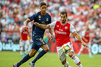 Landover, MD - July 23, 2019: Arsenal Henrikh Mkhitaryan (7) keeps the ball away from Real Madrid Raphael Varane (5) during the match between Arsenal and Real Madrid at FedEx Field in Landover, MD.   (Photo by Elliott Brown/Media Images International)