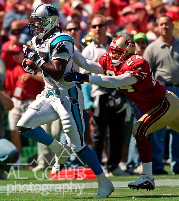 San Francisco 49ers vs. Carolina Panthers at Candlestick Park Sunday, September 10, 2000. Panthers beat 49ers 38-22.  San Francisco 49ers defensive back Monty Montgomery (24) catches up with Carolina Panthers wide receiver Muhsin Muhammad (87).