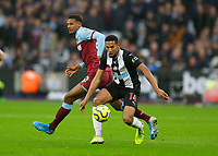 2nd November 2019; London Stadium, London, England; English Premier League Football, West Ham United versus Newcastle United; Isaac Hayden of Newcastle United runs past Sebastien Haller of West Ham United  - Strictly Editorial Use Only. No use with unauthorized audio, video, data, fixture lists, club/league logos or 'live' services. Online in-match use limited to 120 images, no video emulation. No use in betting, games or single club/league/player publications