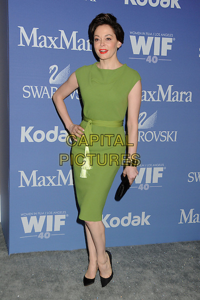 Rose McGowan<br /> Women In Film's 2013 Crystal + Lucy Awards held at The Beverly Hilton Hotel, Beverly Hills, California, USA.<br /> June 12th, 2013<br /> full length dress hand on hip black clutch bag ribbon waist green      <br /> CAP/ADM/BP<br /> &copy;Byron Purvis/AdMedia/Capital Pictures