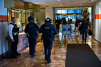 NEW YORK, NY - APRIL 4: A NYPD officers walk next to a Secret Service agent (L) as they patrol inside Trump Tower Where United States First Lady Melania Trump is living on April 4, 2017 in Manhattan, New York. Police Commissioner James O'Neill told lawmakers in February it costs the NYPD between $127,000 and $146,000 a day to protect the first lady and her 11-year-old son Barron. When the president is in town, the city pays more than $308,000.  Photo by VIEWpress/Eduardo MunozAlvarez