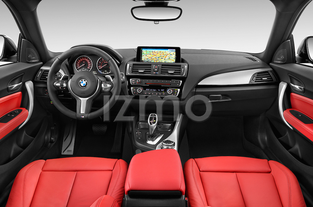Stock photo of straight dashboard view of a 2015 BMW 1 Series M Sport 3 Door Hatchback Dashboard
