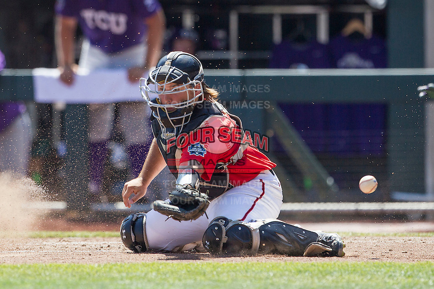 Texas Tech Red Raiders catcher Tyler Floyd (16) misses a throw to the plate against the TCU Horned Frogs in Game 3 of the NCAA College World Series on June 19, 2016 at TD Ameritrade Park in Omaha, Nebraska. TCU defeated Texas Tech 5-3. (Andrew Woolley/Four Seam Images)