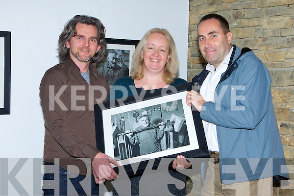 LAUNCH: Maurice Galway (Dingle Festival), Sarah Iremonger (artist) and Barry McCarthy (photographer) at the launch by Barry Fitzgerald of the Blood Sweat and Tears photography exhibition on Mike Murphy - the Ironman in Siamsa Ti?re, Tralee, on Wednesday night.   Copyright Kerry's Eye 2008