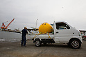 (File Photo) Hiratsuka, Japan - In the file photo released on November 25, 2011 shows a Cosmo Power Co., Ltd. employee unloading Noah's Ark into the water at a port in Hiratsuka, Kanagawa Prefecture, October 20, 2011. Shoji came up with the idea to make Noah's Ark after watching the torrential rain that hit Kyushu approximately 4 years ago. His primary vision for the company is to make products that can save as many people in the future from large natural disasters. The construction process to fully complete a single capsule takes one day but the company aims to make 20 per day. There are currently two models of the safety capsules that can fit up to 4 people (1,200mm) (priced at 315,000 Japanese Yen) and 6 people (1,500mm) (priced at 471,450 Japanese Yen). There has been a demand of buyers for Noah's Ark from countries such as the United States, Brazil, China, Thailand, Bangladesh and New Zealand, however, the company is not ready to sell overseas at present. Shoji mentioned that he plans to make a more advanced model of Noah's Ark in the near future. (Photo by: Christopher Jue/AFLO)