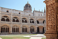 Cloister, built in Manueline style by Diogo Boitac, Joao de Castilho and Diogo de Torralva, completed 1541, in the Jeronimos Monastery or Hieronymites Monastery, a monastery of the Order of St Jerome, built in the 16th century in Late Gothic Manueline style, Belem, Lisbon, Portugal. The cloister wings have wide arcades with rectangular column and tracery within the arches. The monastery is listed as a UNESCO World Heritage Site. Picture by Manuel Cohen