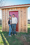 Gabrielle and Clinton Brownlie.<br /> <br /> The Busi family and friends use hot irons to christen and brand the new pump shed at their corrals near Jackson, California.