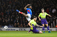 Ellis Harrison of Portsmouth left is tackled by Tom Parkes of Exeter City during Portsmouth vs Exeter City, Leasing.com Trophy Football at Fratton Park on 18th February 2020