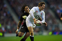 Alex Goode of England passes as he is hunted down by Ma'a Nonu of New Zealand during the QBE Autumn International match between England and New Zealand at Twickenham on Saturday 01 December 2012 (Photo by Rob Munro)
