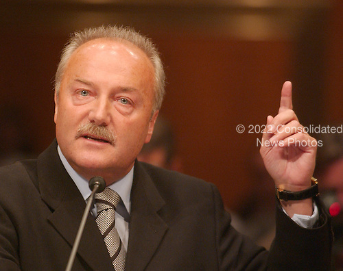 """Washington, D.C. - May 17, 2005 -- George Galloway , Member of Parliament for Bethnal Green and Bow, Great Britain, testifies before the United States Senate Committee on Homeland Security and Governmental Affairs Permanent Subcommittee on Investigations hearing on """"Oil For Influence: How Saddam Used Oil to Reward Politicians Under the United Nations Oil-for-Food Program"""" in Washington, D.C. on May 17, 2005.  .Credit: Ron Sachs / CNP"""