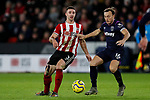 Enda Stevens of Sheffield United and Mark Noble of West Ham United during the Premier League match at Bramall Lane, Sheffield. Picture date: 10th January 2020. Picture credit should read: James Wilson/Sportimage