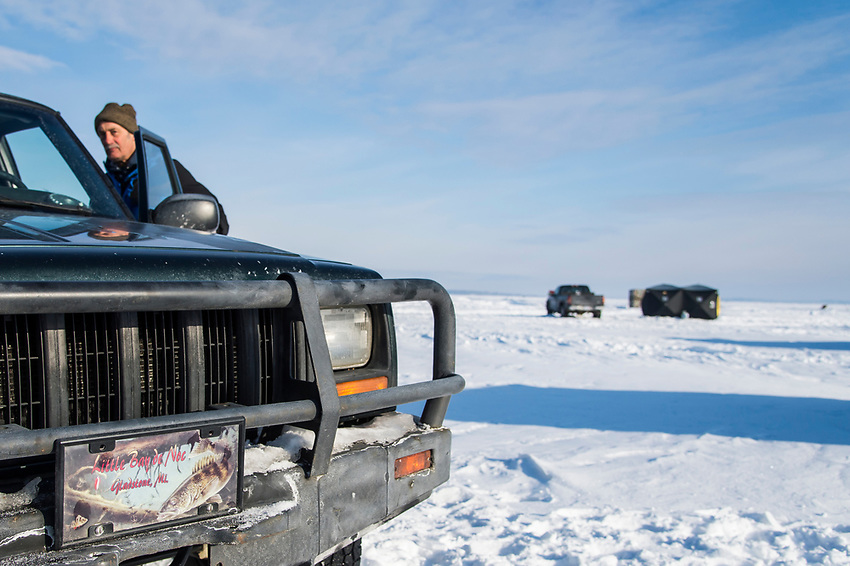 The license plate of an ice fisherman's jeep shows pride in the local fishery of Little Bay de Noc near Gladstone, Michigan.