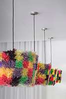The colourful pendant lights in the hotel bar are designed by Lalla Mika and are made from recycled plastic