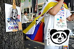 Protesters demanding Taiwan's independence from China plead with passerby to sign a petition outside Yasukuni Shrine in Tokyo, Japan on 15 Aug. 2008.