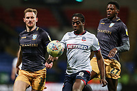 Bolton Wanderers' Clayton Donaldson competing with Sheffield Wednesday's Tom Lees and Dominic Iorfa<br /> <br /> Photographer Andrew Kearns/CameraSport<br /> <br /> The EFL Sky Bet Championship - Bolton Wanderers v Sheffield Wednesday - Tuesday 12th March 2019 - University of Bolton Stadium - Bolton<br /> <br /> World Copyright © 2019 CameraSport. All rights reserved. 43 Linden Ave. Countesthorpe. Leicester. England. LE8 5PG - Tel: +44 (0) 116 277 4147 - admin@camerasport.com - www.camerasport.com