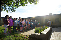 NWA Democrat-Gazette/BEN GOFF @NWABENGOFF<br /> Kyle Schoeller, the school's music teacher, leads the Northside Panther Choir in a few songs Monday, May 15, 2017 during a ribbon-cutting for the new outdoor classroom at Northside Elementary School in Rogers. The school took the oportunity to thank the Rogers Public Education Foundation and local businesses including Lowe's Home Improvement, Milestone Construction Company and Gall Excavation Inc. which made the project possible. The outdoor classroom was complemented by raised planting beds and benches made by local Eagle Scouts, and a butterfly garden built by teachers.